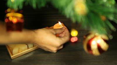 stock-footage-christmas-candle-burning-xmas-candle-burning-burning-the-candle-with-the-match